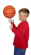 Boy spinning ball on fingers