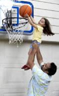 Dad Lifting Girl to Net