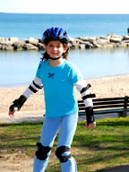 Young Girl rollerblading with helmet