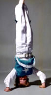 Boy doing head stand