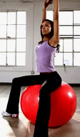 Sitting on pilates ball
